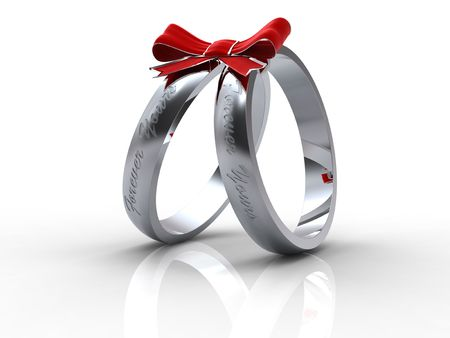 Silver wedding rings with with red bow on white background