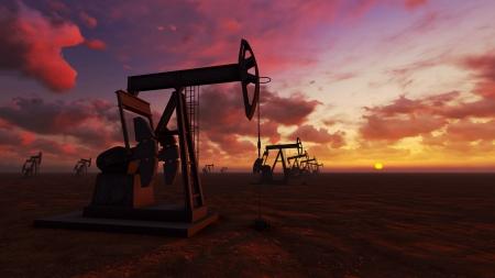 Oil field pump jacks at  sunset