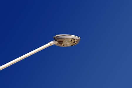 Single column light on blue sky background