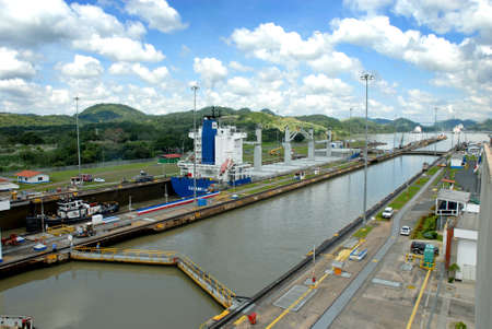 PANAMA – SEPTEMBER 10. Cargo ship crosses locks on September 10, 2006 in Panama Canal. Located at the narrowest point between the Atlantic and Pacific oceans, the Panama Canal has had a far-reaching effect on world economic development.