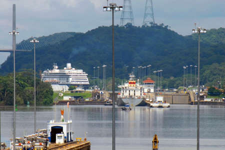 PANAMA – SEPTEMBER 10. Cargo ship and cruiser crosses on September 10, 2006 in Panama Canal. Located at the narrowest point between the Atlantic and Pacific oceans, the canal has had a far-reaching effect on world economic development.