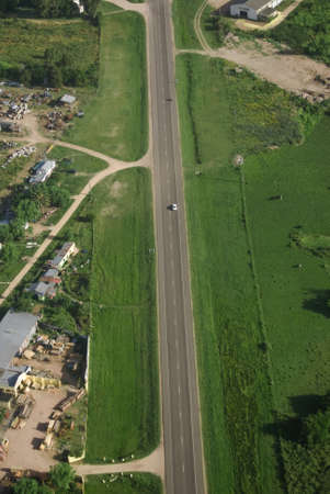 Aerial view of road in green fields in Uruguay.