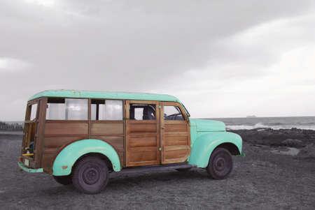 Foto de Go on a summer adventure colorful hipster van in monochrome beach landscape. - Imagen libre de derechos