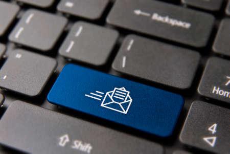 Foto de Web mail computer keyboard button for business mailing list or newsletter concept. New email icon key in blue color. - Imagen libre de derechos