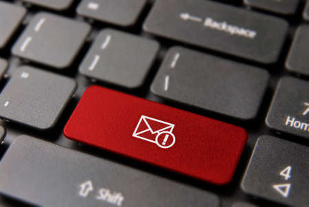 Web mail alert computer keyboard button for new email notification concept. Message envelope icon key in red color.