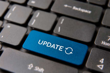 Online update computer keyboard button for internet software concept. Updating process keypad key in blue color.