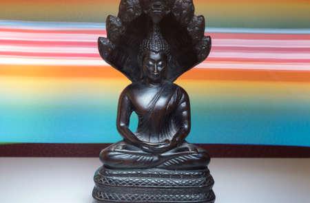 Black Bouddha statue with lights