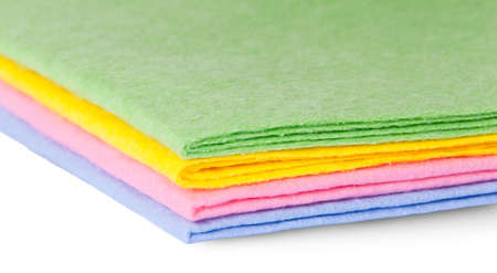 Closeup multicolored cleaning cloths isolated on white background