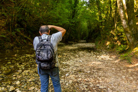 Photo for hiker take a photo in the woods trekking in Varo della Spina to Montella Avellino - Royalty Free Image