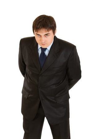 Strict businessman attentively looking at you isolated on white