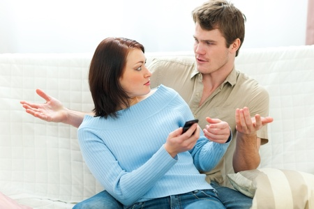Angry girl checking boyfriends cell phone