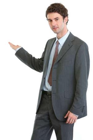 Modern businessman showing on something