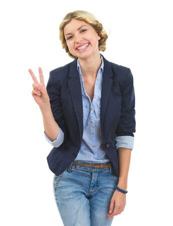 Happy teenage girl showing victory gesture