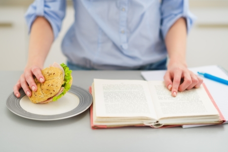 Closeup on teenage girl studying in kitchen