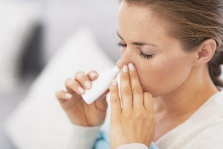Woman using nasal drops