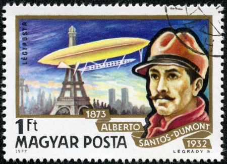 HUNGARY - CIRCA 1977  A Stamp printed in HUNGARY shows a Brazilian aviation pioneer Alberto Santos-Dumont and his dirigible over Eiffel Tower in Paris, circa 1977