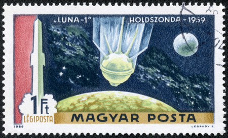 HUNGARY - CIRCA 1969  A stamp printed in Hungary shows rockets picture, Moon and satellite Luna 1, with the inscription  Luna 1, 1959 , from the series  First Man on the Moon , circa 1969