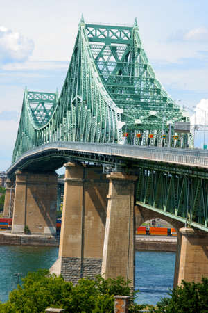 Jacques Cartier bridge crossing Saint Lawrence river in Montreal