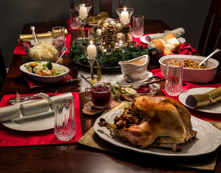 Photo for Close up of a Christmas dinner table complete with turkey and all the fixings including gravy and cranberry sauce. - Royalty Free Image