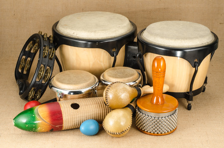 Image of latin percussion set on brown sack background
