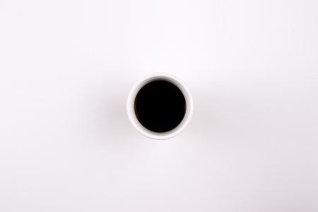Photo pour A coffee mug with black coffee in it on light background - image libre de droit