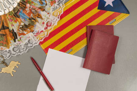 The trip to Catalonia. Copy space. Passports fan flag.