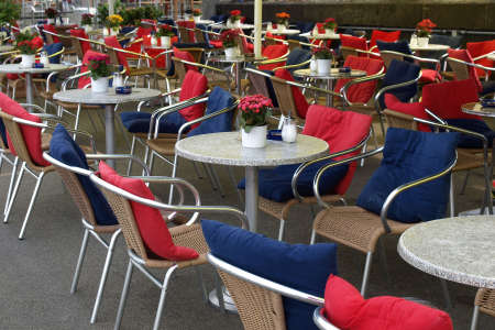 Many tables with chairs in alfresco bar