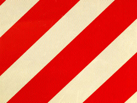 Reflective red and white stripes on a traffic sign