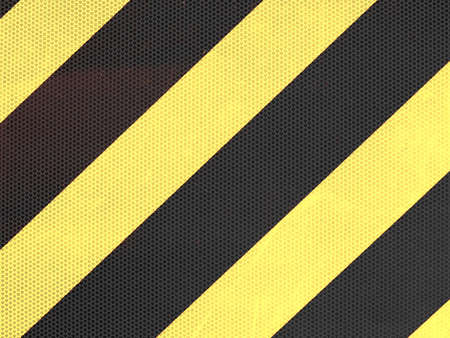 Reflective yellow and black stripes on a traffic sign