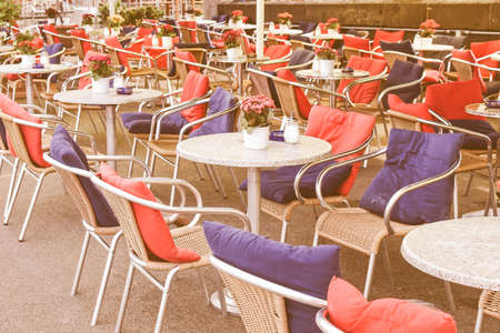 Many tables with chairs in alfresco bar vintage