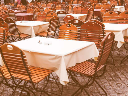 Tables and chairs of a dehors alfresco bar restaurant pub vintage