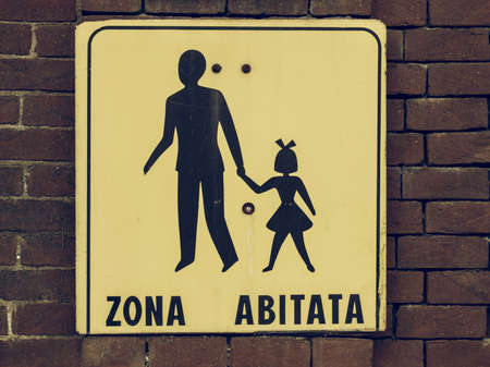 Vintage looking Italian residential area (Zone abitata) sign over a wall
