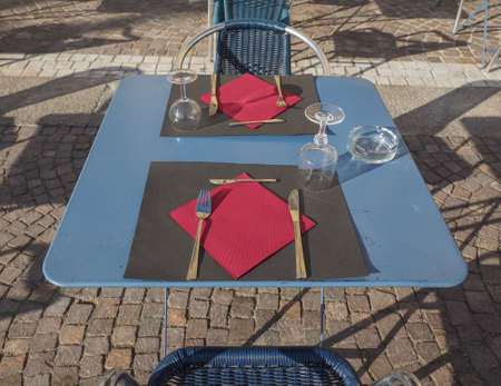Table and chairs at outdoor alfresco bar dehors