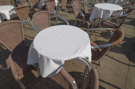Many tables and chairs at an outdoor alfresco bar