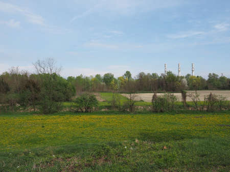 Panorama with chimneys of power station in Chivasso, Italy