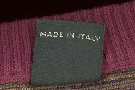 Photo pour Made in Italy label on a woolen jumper jersey sweater garment - image libre de droit