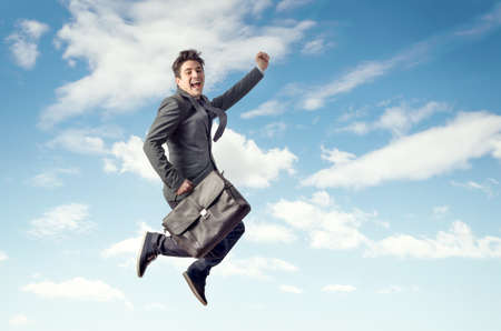 Young business man jumping for joy