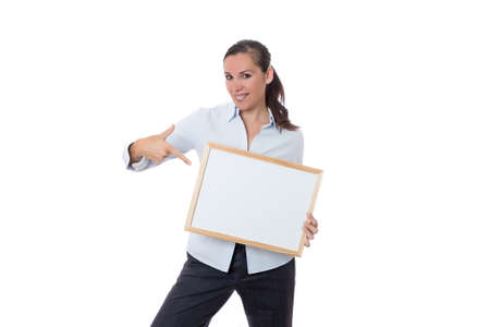 woman standing with a small whiteboard indicating