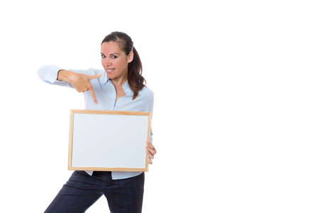 smiled business woman standing with a small whiteboard indicating isolated on a white background