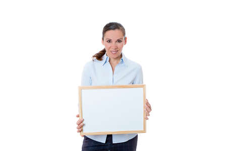smiling young business woman standing with a small blank whiteboard isolated on a white background