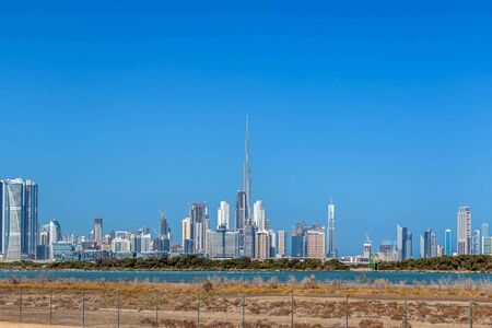 Photo pour Dubai, United Arab Emirates 12/12/2019 - Waterfront view of Burj Khalifa, World Tallest Tower. A view from Sheikh Zayed Road, Residential and Business Skyscrapers in Downtown, Dubai, UAE - image libre de droit