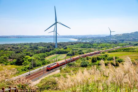 Photo for rainway at the coastline with wind turbine in Miaoli, Taiwan - Royalty Free Image