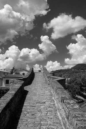 Modigliana (Forli Cesena, Emilia Romagna, Italy): the medieval bridge known as Ponte di San Donato, or Ponte della Signora. Black and white