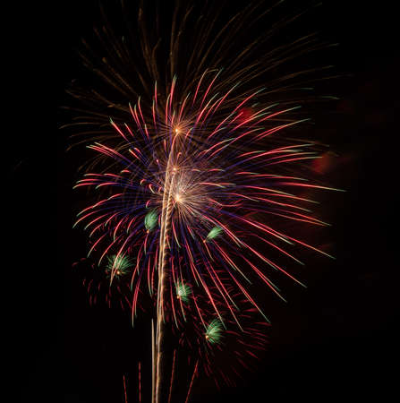 beautiful of exploding fireworks at night. Represents a celebration.