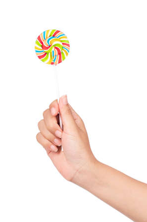 hand holding Colorful spiral lollipops isolated on white background