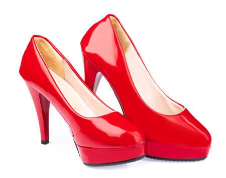 Foto de Red shoes isolated on white background - Imagen libre de derechos