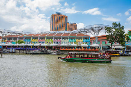 Photo for SINGAPORE - FEBRUARY 19, 2017:Tourist boat on the Singapore river along the Clarke Quay - Royalty Free Image