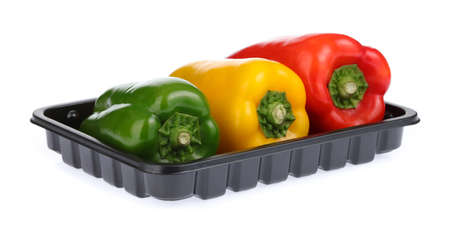 Foto de three bell peppers on Black Plastic food Tray isolated on white background - Imagen libre de derechos