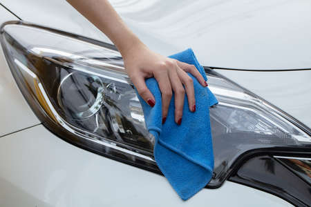 Photo for Hand with cloth washing a car. - Royalty Free Image