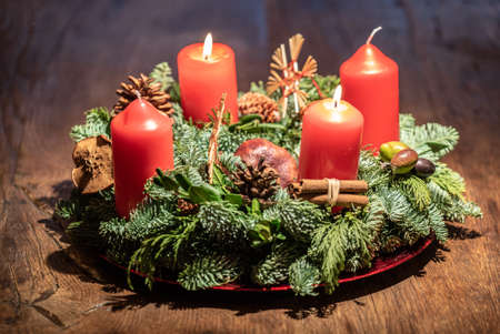 studio shot of a nice advent wreath with baubles and one. Black Bedroom Furniture Sets. Home Design Ideas